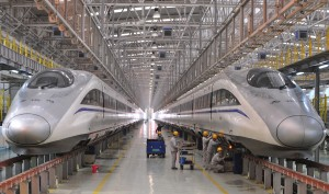 Employees inspect a bullet train at a high speed railway maintenance station, to prepare for the annual mass migration ahead of the Chinese lunar new year, in Xi'an