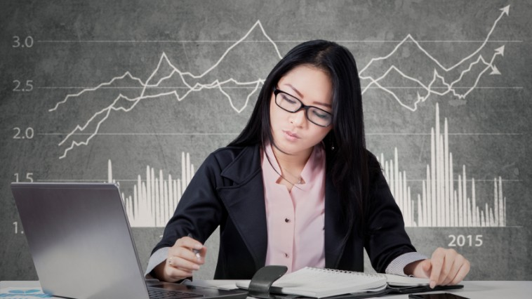 Busy worker with financial statistic background